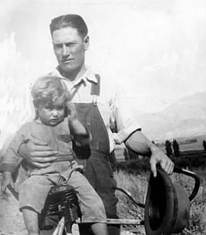 Young Allan with his dad in Elberta