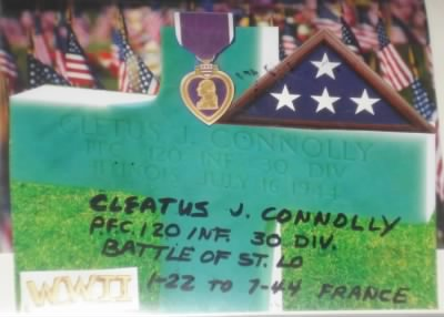 Cleatus J Connolly (Jr.) His Cross in the front row facing the Beach at Normandy.