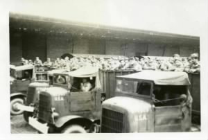 59. loading onto  the trucks.jpg