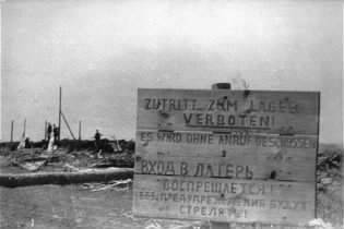 A sign at the entrance to the Maly Trostinets concentration camp warns that trespassers will be shot without warning.jpg