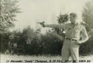 "321stBG,448thBS, Lt ""Sandy"" Thompson shoots a German LUGER... 1944, MTO"