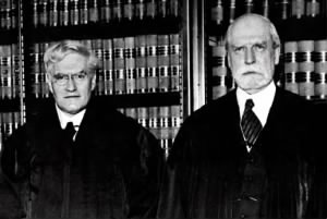 Columbian Supreme Court Justices Benjamin Nathan Cardozo (left) and Charles Evans Hughes.jpg
