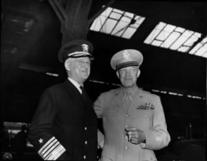 Admiral Stark and General Eisenhower awaiting President Truman.jpg