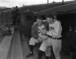 Honus Wagner with Player Pie Traynor 1938.jpg