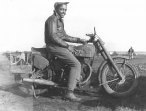1Lt. George T. McCrumby on a bike.jpg