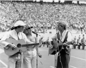 Bill Danoff and Taffy Nivert with John Denver at the West Virginia University.jpg